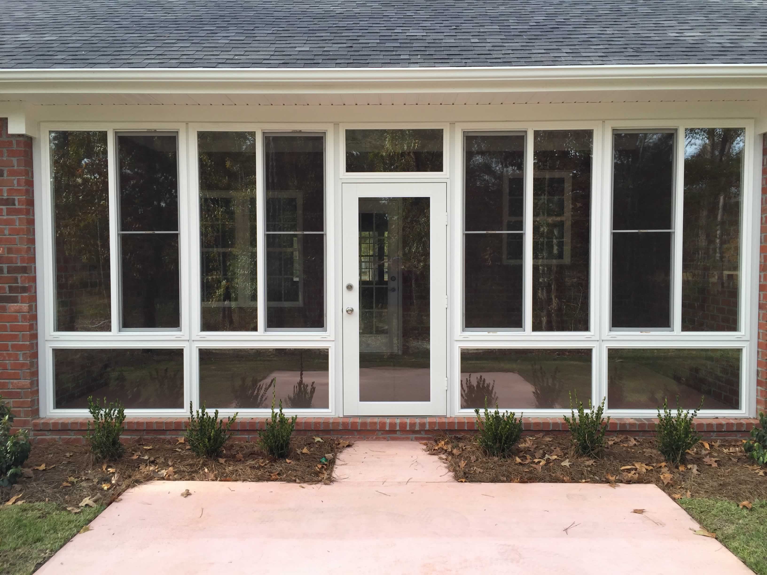 glass sunroom with fixed glass door